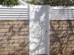 Vinyl Man Gate in Block Wall