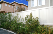 Vinyl Privacy Fencing on Block Retaining Wall