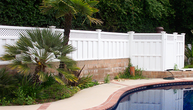 Vinyl Privacy Fencing on Block Wall with Pool Enclosure